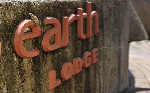 Earth Lodge Sign